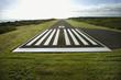 Leinwanddruck Bild - Airplane landing strip.