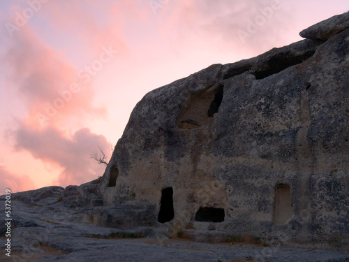 Ruins of old cave town at sunset