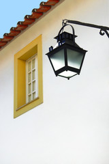 white wall with an old typical street-lamp and window