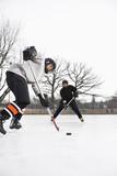 Fototapety Boys playing ice hockey.