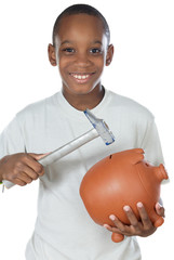 Boy with a hammer breaking a money box