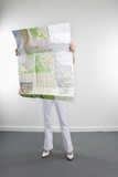 Full length portrait of Caucasian woman holding map. poster