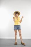 Caucasian woman in summer attire talking on cellphone. poster