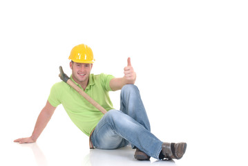 Handsome  successful construction worker with pickax