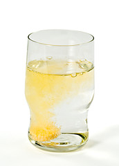 Glass with orange  sparkling tablet