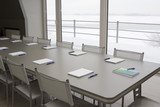 Meeting room of grey, steel color. A grey table with grey chairs poster