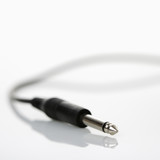 Mono audio plug on cord. poster