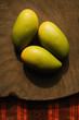 Three wooden mangoes.