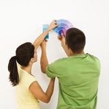 Couple choosing home color. poster