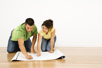Couple with house plans.
