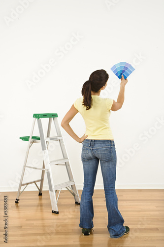 Woman choosing paint color.