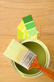 High angle view of paintbrush resting on paint can. poster