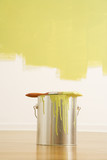 Still life of paintbrush on paint can with painted wall. poster