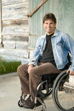 disabled man in wheelchair, smiling poster