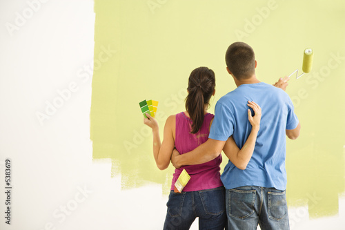 Couple painting home.