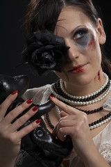 retro portrait of gothic lady with leather teddy-bear