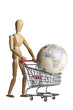 Mannequin pushing a shopping cart with an earth globe
