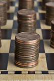 Chessboard with stacks of pennies  poster