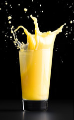 Orange juice splash on a black background