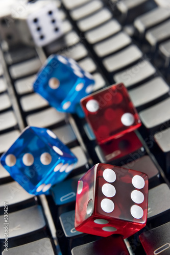 Dice on a computer keyboard