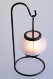 metal candlestick with shining candle poster