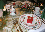 Christmas table with decorative porcelain, candles  poster