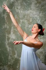 Ballerina raising hands during a performance.