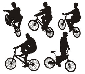Five bicycle riders silhouettes