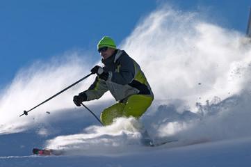 extreme freeride skier moving down on ski slope