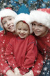 Children wearing Santa Claus hats and snowflake frame