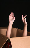 hands emerging from a box poster