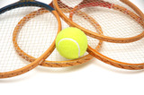 Tennis rackets and ball isolated on white