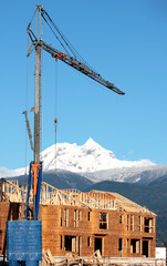A crane seems to tower over a peak near Whistler, BC, Canada.
