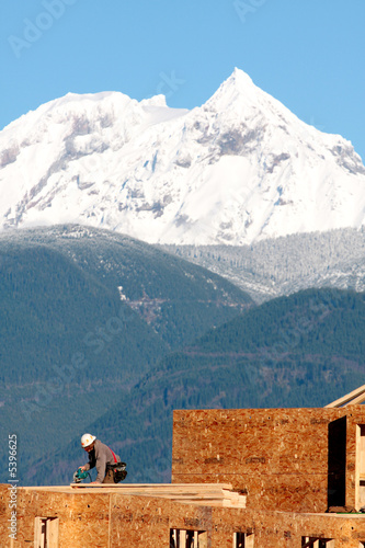 A carpenter works near Whistler, site of the 2010 Olympic Games.