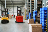 Busy warehouse with pallet trucks working