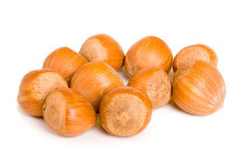 Ten hazelnuts on a white background