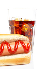 Hot dog and soda, reflected on white background. Shallow DOF