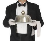 Waiter torso holding a silver tray poster