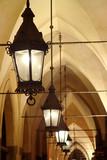 Old stylish lanterns illuminating gothic arcade poster