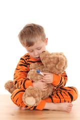 3-4 years old boy in pyjama whit his friend isolated on white