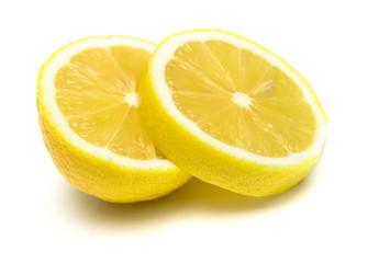 The tropical fruit known as lemon, cut across.