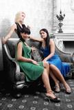 Three beautiful girls in luxury monochrome interior poster
