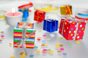 Colorful gifts with shining ribbons on white background