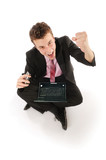Young smart businessman with cellphone and laptop  poster