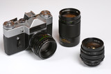 Old soviet 35mm film camera with normal, wide and tele lenses poster