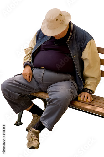Isolated image of heavy older gentleman asleep on city bench.