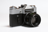 Old soviet 35 mm film camera isolated on white poster