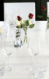Elegant table setting with red roses and white linen. poster