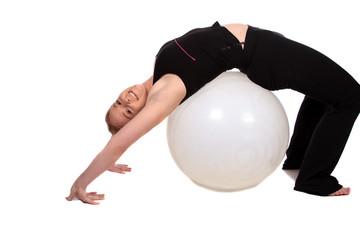 Aerobics over an exercise ball bending the back