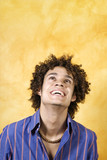 facial expressions: guy with curly hair smiling poster